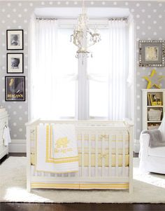 Grey, white, & yellow nursery. Why This Room Works  Gray and yellow make a fresh, unexpected palette for this room that was designed to welcome a girl or a boy. A polka-dot pattern painted on the walls increases a sense of height, with a plush rug adding inviting texture underfoot. hung wall art that features darker shades of gray and black to add depth and interest.