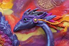 Yes, it is polymer clay - Sunset Dragon Journal by Etsy seller MyMandarinDucky. She makes some amazing things!