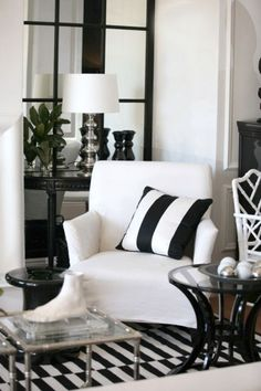 Black and white living room décor | White arm chair | Striped decorative pillow