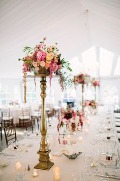 tall centerpieces, photo by Brooke Courtney Photography http://ruffledblog.com/sophisticated-wedding-at-moonstone-manor #centerpiece #weddingideas