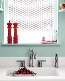 A sheer fabric shade adds a touch of retro chic to kitchen decor.