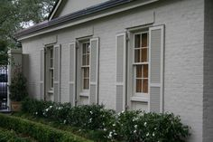 """""""These shutters made larger than the windows, along with the upper cap, add character to these smallish windows and make them much more prominent."""""""