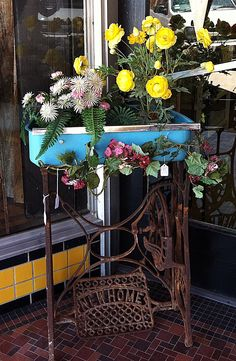 An Old Sewing Machine Base Married to a Fabulous Old Refrigerator Drawer Makes an Awesome Planter! villag antiqu, town villag, machin cabinet, machin base, sew vintag, sew machin, junki garden, old sewing machines