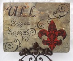 ULL Ragin Cajuns Fleur de lis on Recycled New Orleans Roofing Slate.