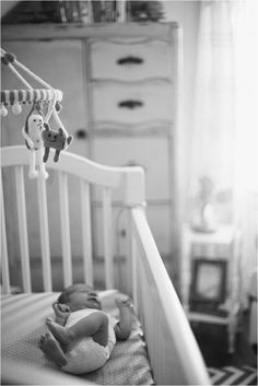 beautiful picture of new baby in their nursery