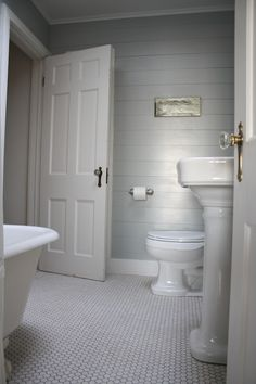 DIY ~ Use reclaimed wood or shiplap wall paneling to give your bathroom texture & that old cottage feel