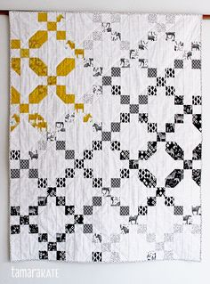 Tamara Kate's Origami Oasis fabric made into starry migration quilt - with link to free pattern