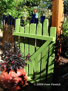 love this garden gate to go with wooden fences!