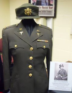 The uniform of Army Combat Nurse Phyllis (Wollenberg) Mirfield.She completed her nurse training at Fort Devens in 1944 and was deployed to Europe with the 85th Field Hospital.She followed the troops and attended to their wounds in France,Beligum,Germany. She was awarded the European Campaign Medal with two battle stars. After the war, Phyllis was a nurse for the Carlisle School District and the Emerson Hospital in Concord, MASS  ~