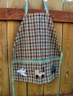 Child's apron...CUTE for an apron for a boy to wear when painting! :)