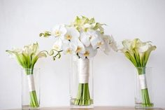 orchid and calla lily bouquets. they look amazing! want!