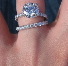Love love loooove this. Circular diamond with thin band that matches the wedding band. The wedding band and engagement band don't have to have diamonds, I'd actually prefer a just plain silver band!