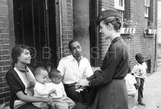 Visiting Nurse Pera meets with a family outside their home to discuss the health of their children, Community Nursing Services of Philadelphia, c. 1964. Image courtesy of the Barbara Bates Center for the Study of the History of Nursing.