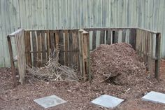 New compost pile made from staking poles and 5 old pallets.