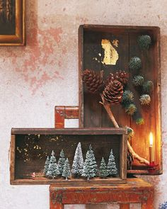 I love this idea! Use boxes and drawers with a bit of history. Get your trees and figures from the model train department in the toy shop and decorate with gold leaf, little stars or whatever else suits the scene you want to create.