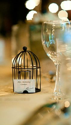 "Beautiful, intimate, love birds themed wedding reception guest favors ""Love Songs"" Birdcage Tea Light/Place Card Holder http://favorcouture.theaspenshops.com/product/a.html"