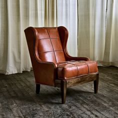 A wing back gives a welcome hug and then just wraps around one for the duration!  Love warm leather too.  K.W.