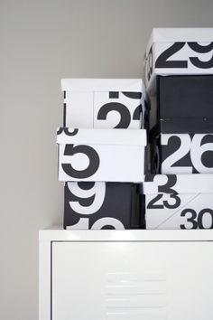 shoe boxes covered in Stendig calendar