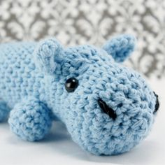 A cute baby blue amigurumi hippo.  Tips and tricks on how to crochet this adorable doll.