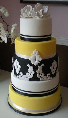 Damask wedding cake in yellow, white and black.