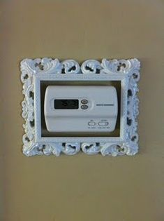 Modern thermostats are boring and unattractive, but necessary...so why not pretty it up? Spray paint an interesting frame and voila! Great idea!