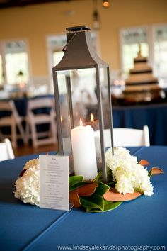 lantern centerpiece with magnolia leaves