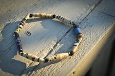$4 plus shipping Recycled Paper Bead Elastic Bracelet.    With each purchase help fight HIV/AIDS and provide clean drinking water to those struggling in Africa. 10% of each purchase will be donated to Blood:Water Mission.