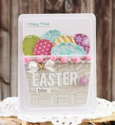 Weave an Easter basket using paper in neutral shades, round the corners and add some pretty borders.  Eggs made from oval punches and lined with chunky glitter make a pretty handmade Easter card.