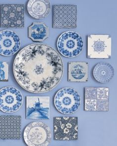 Porcelain Blue - collections of Delft tiles and transferware plates.  What a pretty wall display!