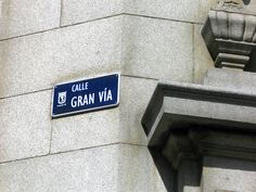 "Gran Via of Madrid plate - near of Rex Hotel. The section of the Gran Via in Madrid that runs from the Plaza Callao to Plaza España, was once known and highly attended for having many movie theatres along the way. Today, the ""Broadway of Madrid"" as it is popularly called, features some of those old buildings, now fully renovated as musical theaters."