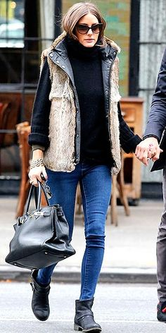 Fur vest queen Olivia Palermo updates the fall staple with some leather trim. fashion, furs, dress, street style, outfit, olivia palermo, closet, boots, fur vest