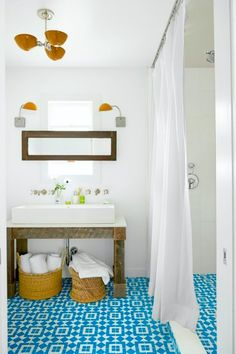 Trendy Bathroom Tiles: blue #spanish style #bathroom tiles with woven baskets for storing #bath towels