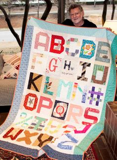 """Mr Dunn, owner of Moda Fabrics with his """"Spell it with Fabric"""" quilt.  Each designer did a block.  Moda... the Cutting Table  @modafabric"""