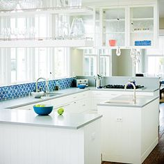 Simple kitchen gets injection of personality with blue and white backsplash tile. Clean lines and great counters too!