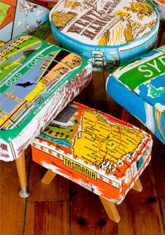 More tea towel upholstery! Hilarious! Mid-century footstools re-upholstered vintage souvenir linen tea towels - could be cute chairs for the girls