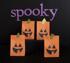 Inexpensive paper Halloween Decorations - we love these festive pumpkin paper bags!
