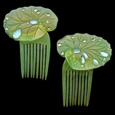 Ella Naper Lily-Pad Combs | Ella made this pair of lily-pad combs out of green-tinted horn, and created the dewdrops from moonstones, c. 1906. Barbaraanne's Hair Comb Blog