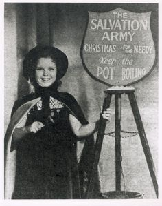 Shirley Temple ringing the bell for those in need
