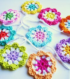 crochet flowers, frames, old suitcases, flower garland, yarn, diy projects, bright colours, bright colors, mini flower