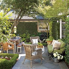 Narrow plant beds create the perfect layout for an outdoor living room.