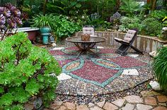 Pebble mosaic is an art I'd love to see more of. This exquisitely detailed lotus-shaped patio brings to mind tropical Asian destinations. Designed and installed by Jeffrey Bale Garden Design.