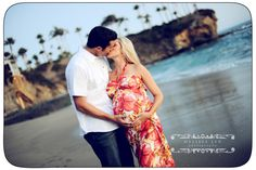 maternity beach couple pose