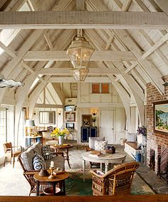 French Normandy cottage interior: white-washed post and beam, flagstone floors, reclaimed brick fireplace - photo: Tim Street-Porter