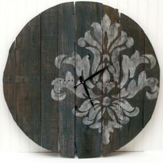 Create your own giant stencilled pallet clock for an eye catching statement piece with this easy tutorial.