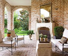 Understated furniture lets this porch's traditional architecture stand out. More ideas for outdoor porches: http://www.bhg.com/home-improvement/porch/porch/outdoor-porch-design-and-decorating/?socsrc=bhgpin051413brickpatio=9