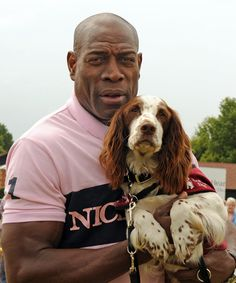 Boxing legend Frank Bruno with hearing dog Spaniel Bertie at the Hearing Dogs for Deaf People Summer Show 2011