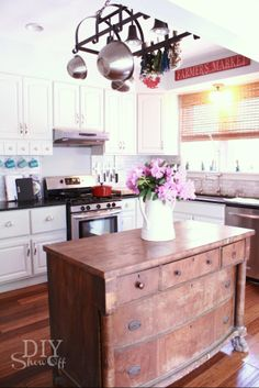 DIY Showoff Summer Home Tour.  I love the dresser used as an island, the pot rack, and the whole kitchen.