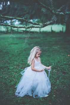 tulle dress flower girl, photo by Papered Heart Photography http://ruffledblog.com/brooksville-florida-wedding #flowergirl