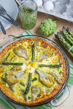 Asparagus, Baby Artichoke, Pesto and Goat Cheese Quiche with Quinoa Crust. #recipes #foodporn #quiches #vegetarian