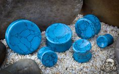 Concave synthetic turquoise plugs